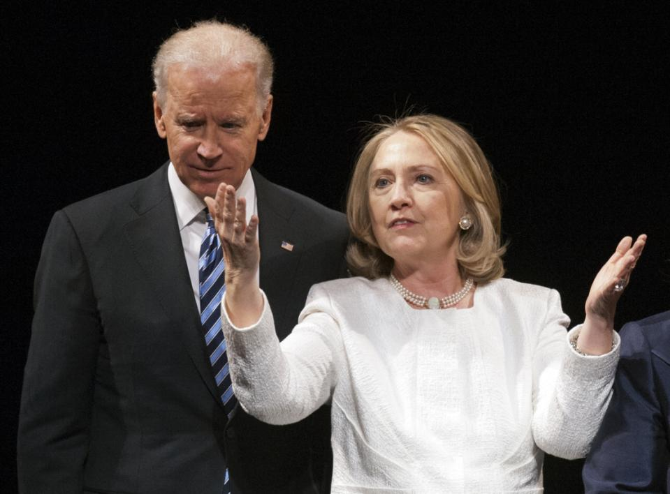 FILE- In this April 2, 2013, file photo, Vice President Joe Biden and Hillary Rodham Clinton appear onstage at the Vital Voices Global Partnership 2013 Global Leadership Awards gala in Washington. As Biden ponders a challenge to Clinton for the Democratic nomination, she has rolled out a string of high-profile endorsements in the early voting contests of Iowa and South Carolina and scheduled an onslaught of fundraisers across the country in the effort to throw cold water on a possible Biden bid. (AP Photo/Cliff Owen, File)