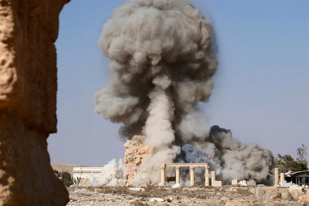An image released by ISIS purportedly shows smoke billowing from the Baal Shamin temple in Syria's ancient city of Palmyra. ISIS / via AFP - Getty Images