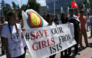 (Photo: Reuters/Denis Balibouse) Women hold a banner during a demonstration marking the first anniversary of Islamic State's surge on Yazidis of the town of Sinjar, in front of the United Nations European headquarters in Geneva, Switzerland, August 3, 2015.