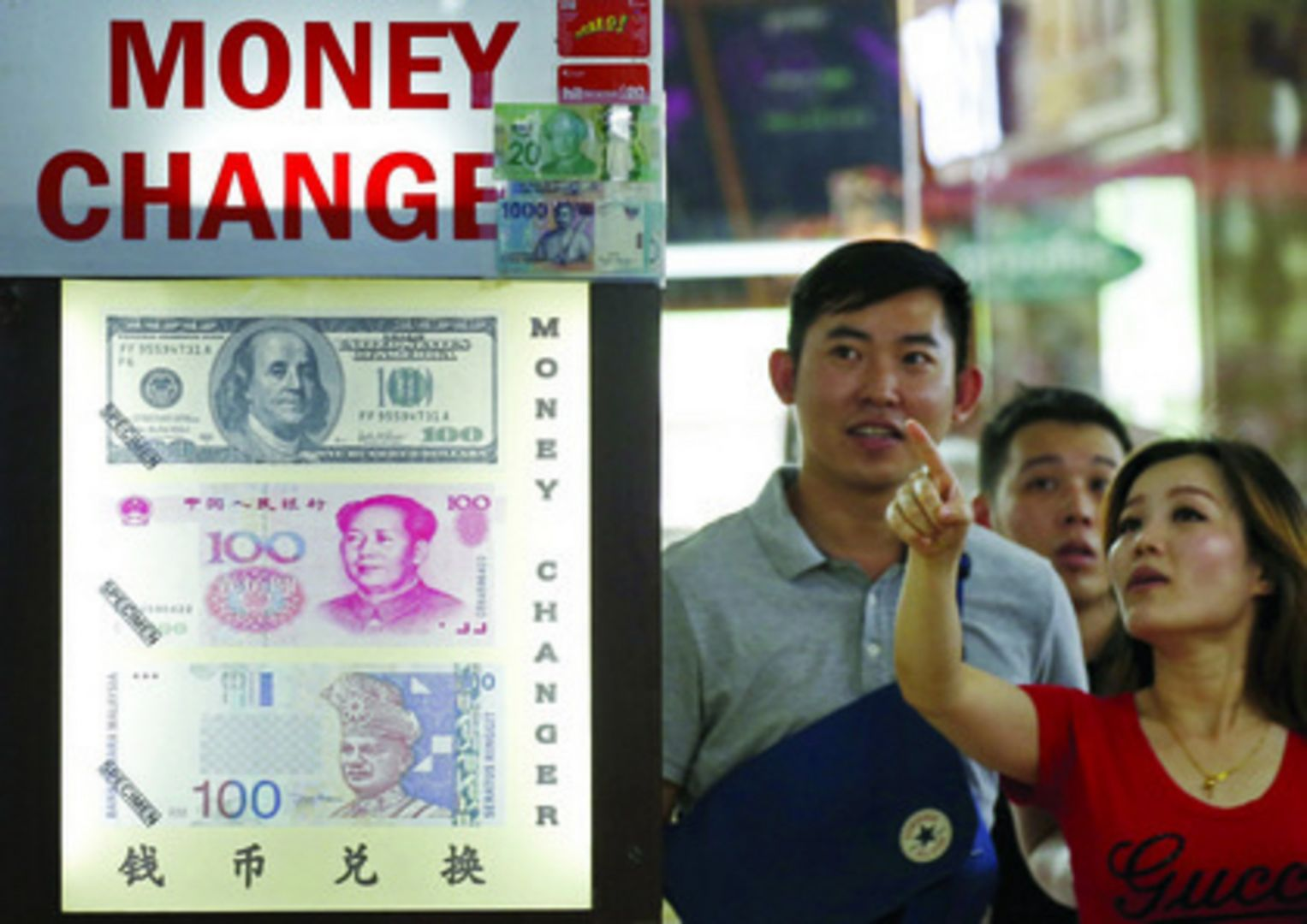 The ringgit's free-fall led to a surge in demand for the currency in Singapore, with many people flocking to money changers yesterday. Photo: REUTERS