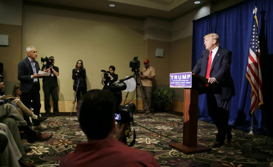 Miami-based Univision anchor Jorge Ramos, left, asks Republican presidential candidate Donald Trump a question about his immigration proposal during a news conference, Tuesday, Aug. 25, 2015, in Dubuque, Iowa. (AP Photo/Charlie Neibergall)