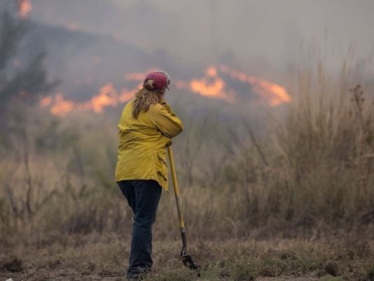 OMAK, WA - AUGUST 22: A spotter keeps and eye on a wildfire, which is part of the Okanogan Complex, as it burns brush on August 22, 2015 near Omak, Washington. The fires have burned more tha 127,000 acres. (Photo by Stephen Brashear/Getty Images)(Photo: Stephen Brashear, Getty Images)
