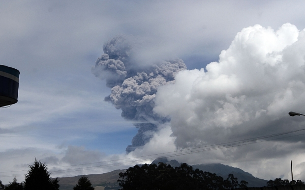 View of the Cotopaxi volcano spewing ashes in Pichincha province, Ecuador on August 14, 2015. The volcano spewed a column of ash five kilometers (3 miles) high on Friday, prompting officials to raise the alert level. AFP PHOTO / JUAN CEVALLOSJUAN CEVALLOS/AFP/Getty Images