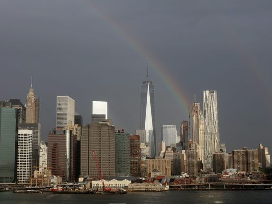 A rainbow streaks across the sky over One World Trade Center in New York on Sept, 10 2015.(Photo: Andrew Gombert, epa)