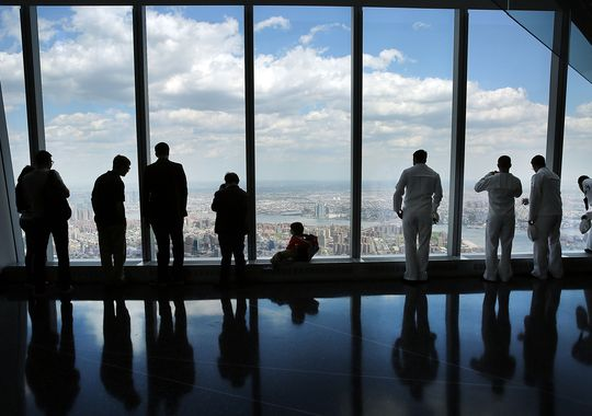 People look out from the newly built observation deck at One World Trade Center on May 22, 2015. (Photo: Spencer Platt, Getty Images)