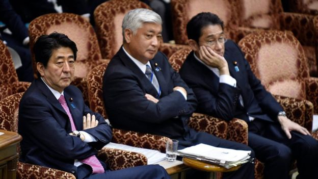 Earlier, Prime Minister Shinzo Abe (left) and his defence and foreign minsters waited for hours in a nearly empty committee room