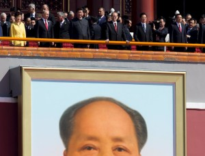 Chinese President Xi Jinping (front, 3rd L) stands with South Korean President Park Geun Hye (front L-R), Russian President Vladimir Putin, former Chinese Presidents Jiang Zemin, Hu Jintao and Chinese Premier Li Keqiang as they arrive to watch a military parade to commemorate the 70th anniversary of the end of World War Two in Beijing September 3, 2015. Xi announced on Thursday he would cut troop levels by 300,000 as China held its biggest display of military might in a parade to commemorate victory over Japan in World War Two, an event shunned by most Western leaders. REUTERS/Andy Wong/Pool