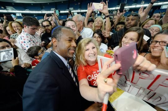 Physician Tamara Hoover takes a selfie with Carson during a campaign rally in Anaheim, Calif. (Photo: Kevork Djansezian/Getty Images)