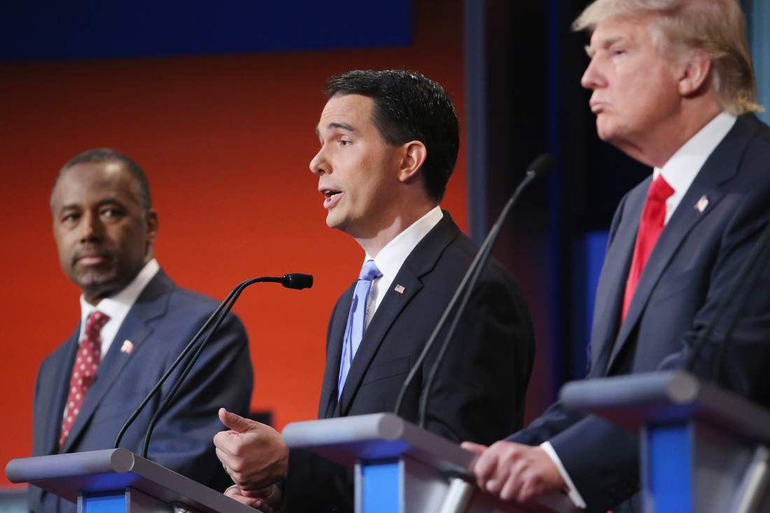 CLEVELAND, OH - AUGUST 06: Republican presidential candidates (L-R) Ben Carson, Wisconsin Gov. Scott Walker and Donald Trump participate in the first prime-time presidential debate hosted by FOX News and Facebook at the Quicken Loans Arena August 6, 2015 in Cleveland, Ohio. The top-ten GOP candidates were selected to participate in the debate based on their rank in an average of the five most recent national political polls. (Photo by Chip Somodevilla/Getty Images)