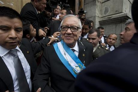 Guatemala's new President Alejandro Maldonado leaves the Congress building after his swearing-in ceremony in Guatemala City, Thursday, Sept. 3, 2015. Maldonado was sworn in amid a corruption scandal that has caused a national political crisis. The conservative former judge will serve out the term of former President Otto Perez Molina, who resigned late Wednesday after a judge issued an order for this detention. Prosecutors accuse the ex-president of leading a customs fraud ring. (AP Photo/Esteban Felix)
