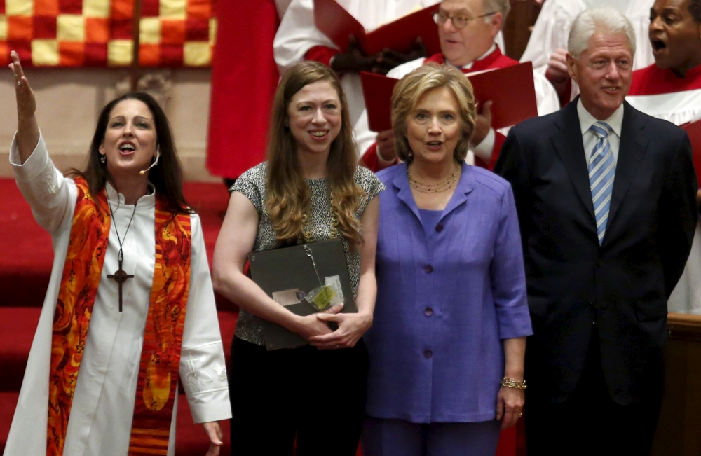 U.S. Democratic presidential candidate Hillary Clinton (2nd R) with her husband, former U.S. President Bill Clinton (R) and their daughter Chelsea attend the Foundry United Methodist Church's bicentennial service in Washington, September 13, 2015.