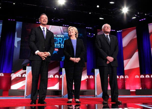 Democratic U.S. presidential candidates (L-R) former Governor Martin O'Malley, former Secretary of State Hillary Clinton and U.S. Senator Bernie Sanders pose together before the start at the Democratic presidential candidates debate in Charleston