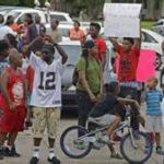 Protests erupt in Baton Rouge over police shooting