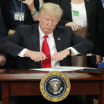 Trump defends immigration executive order